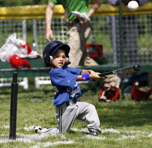 A player of the Jose M. Rodriguez Little League Angels from Manati, Puerto Rico hits the ball during the 2008 Tee Ball on the South Lawn Season Opener Monday, June 30, 2008, on the South Lawn of the White House. White House photo by Eric Draper