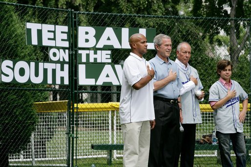 President George W. Bush is joined during the playing of the National Anthem by Roberto Clemente Jr., left, son of Hall of Famer Roberto Clemente; Angel Macias, who in 1957 became the only player to pitch a perfect game in Little League World Series history, and actor Jake T. Austin, right, who will portray Macias in an upcoming film about that game, seen together Monday, June 30, 2008, at Tee Ball on the South Lawn at the White House. White House photo by Chris Greenberg