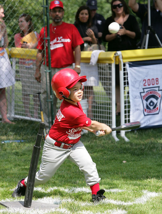 A player for the Cramer Hill Little League Rex Sox of Camden, N.J. hits the ball during the season opening game of the 2008 Tee Ball on the South Lawn Monday, June 30, 2008, on the South Lawn of the White House playing against the Jose M. Rodriguez Little League Angels of Manati, Puerto Rico. White House photo by Chris Greenberg
