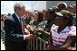 President George W. Bush greets base personnel and their families at the Air National Guard Ramp of Jackson-Evers International Airport Tuesday July 1, 2008, in Jackson, MS. White House photo by Joyce N. Boghosian