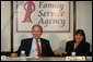President George W. Bush holds the hand of Patty Couch during a roundtable discussion on Housing Counseling, Tuesday, July 1, 2008 at Family Service Agency Inc. in North Little Rock, Arkansas. White House photo by Joyce N. Boghosian