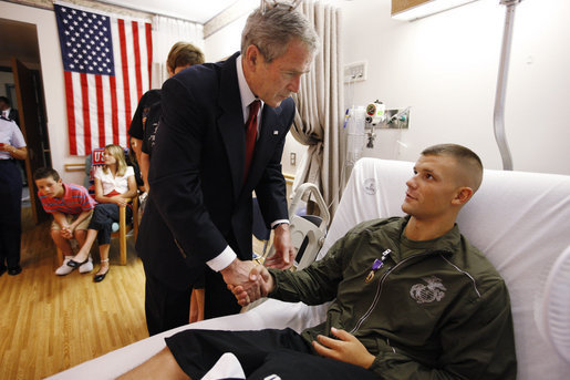 President George W. Bush shakes hands after awarding a Purple Heart medal to U.S. Marine Corps Pfc. Jacob Brittain of Frankfort, Tenn., Thursday, July 3, 2008, at the National Naval Medical Center in Bethesda, Md. White House photo by Eric Draper