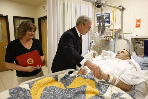 President George W. Bush meets with U.S. Marine Corps Sgt. Maj. Patrick Wilkinson and his wife, Jennifer, of Temecula, Calif., Thursday, July 3, 2008, at the National Naval Medical Center in Bethesda, Md., where President Bush presented Wilkinson with a Purple Heart medal. White House photo by Eric Draper