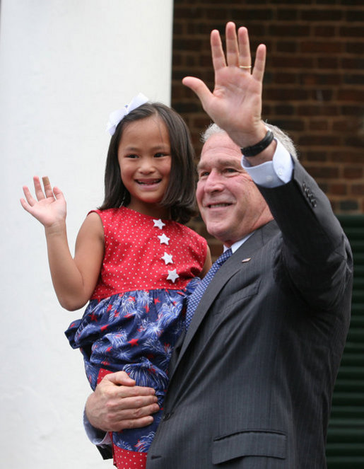 President George W. Bush holds Julia White Freeman, formerly of China, after she took the Oath of Citizenship at Monticello's 46th Annual Independence Day Celebration and Naturalization Ceremony Friday, July 4. 2008, in Charlottesville, VA. White House photo by Joyce N. Boghosian