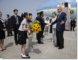 President George W. Bush and Laura Bush are welcomed on their arrival Sunday, July 6, 2008 to the New Chitose International Airport, to attend the Group of Eight Summit in Toyako, Japan.  White House photo by Eric Draper