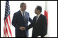 President George W. Bush and Japan's Prime Minister Yasuo Fukuda shake hands at their first meeting Sunday, July 6, 2008, at the Windsor Hotel Toya Resort and Spa in Toyako, Japan, site for this year's 2008 Group of Eight Summit. White House photo by Eric Draper