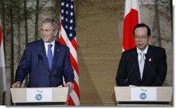 President George W. Bush and Japan's Prime Minister Yasuo Fukuda listen to questions from the audience during a joint press availability Sunday, July 6, 2008, at the Windsor Hotel Toya Resort and Spa. Japan is host to this year's 2008 Group of Eight Summit.  White House photo by Eric Draper