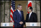 President George W. Bush and Prime Minister Yasuo Fukuda of Japan shake hands after their joint press availability Sunday, July 6, 2008, in Toyako on the northern Japanese Island of Hokkaido. White House photo by Eric Draper