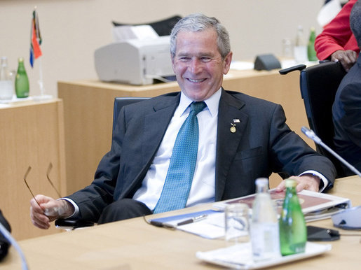 President George W. Bush relaxes prior to the start of the G8 Working Session with Africa Outreach Representatives Monday, July 7, 2008, at the Windsor Hotel Toya Resort and Spa in Toyako, Japan. White House photo by Eric Draper
