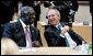 President George W. Bush shares a moment with President John Agyekum Kufuor of Ghana prior to the start Monday, July 7, 2008, of the G8 Working Session with Africa Outreach Representatives in Toyako, Japan. White House photo by Eric Draper