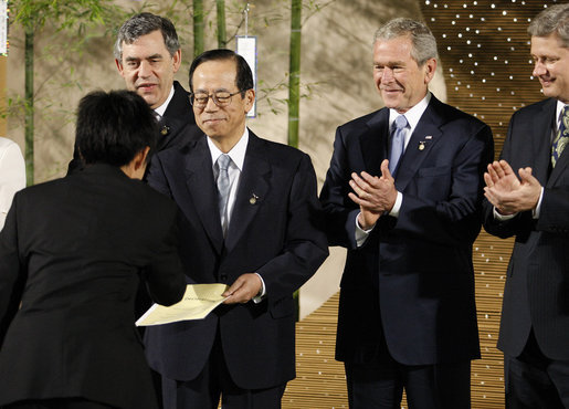 President George W. Bush leads the applause Monday, July 7, 2008, as the Japanese representative from the J-8, young leaders from the Group of Eight countries, presents credentials to Prime Minister Yasuo Fukuda of Japan, host of this year's 2008 G-8 Summit in Toyako, Japan. White House photo by Eric Draper