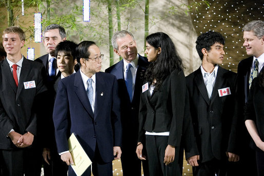 President George W. Bush and Japanese Prime Minister Yasuo Fukuda speak with United States J-8 representative Manogna Manne of Pleasanton, Calif., a member of the J-8 young leaders from the Group of Eight countries, attending the 2008 G-8 Summit in Toyako, Japan. White House photo by Eric Draper