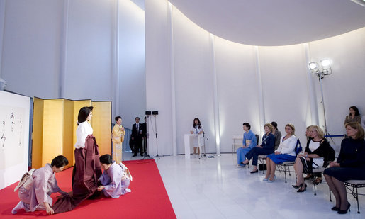 Mrs. Laura Bush joins spouses of G-8 leaders Monday, July 7, 2008, as they participate in a demonstration of a Junihitoe 12-layered Ancient Kimono at the Bridal Chapel and Bridal Salon of the Windsor Hotel Toya Resort and Spa in Toyako, Japan. The event celebrates the 1000th anniversary of the Tale of Genji, a Japanese classic written by Lady Murasaki. Junihitoe means 12 layers, and is an example of the formal court dress worn by women during Murasaki's time. White House photo by Shealah Craighead