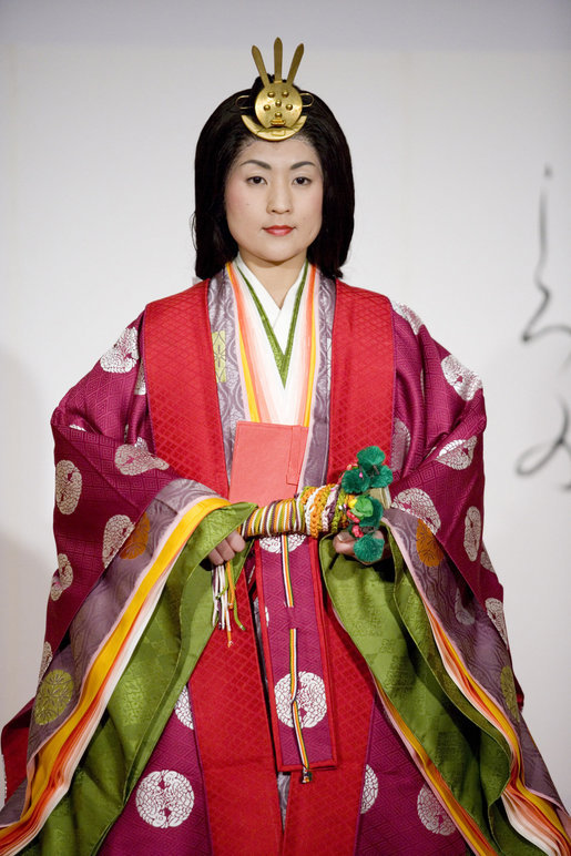 A young woman models a Junihitoe, a 12-layered formal court dress worn by women during the Heian period, during a demonstration of traditional Japanese culture Monday for G-8 spouses at the Windsor Hotel Toya Resort and Spa in Toyako, Japan. White House photo by Shealah Craighead