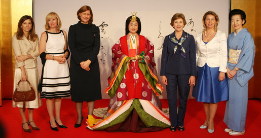 Spouses of G-8 leaders pose with a model dressed in a Junihitoe, a 12-layered ancient kimono, following a demonstration of traditional Japanese culture Monday, July 7, 2008, in Toyako, Japan. From left, the spouses are: Mrs. Margarida Uva Barroso, Mrs. Laureen Harper, Mrs. Sarah Brown, Mrs. Laura Bush, Mrs. Svetlana Medvedeva, and Mrs. Kiyoko Fukuda. White House photo by Shealah Craighead