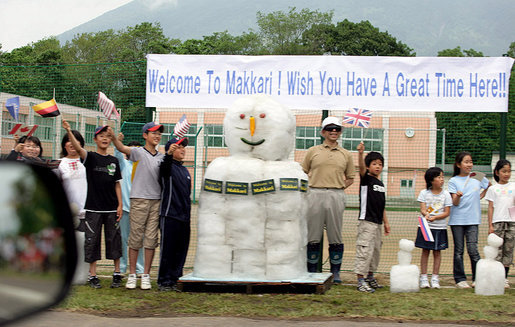 Flag-waving youngsters and a snowman welcome the G-8 Spouses to Makkari Tuesday, July 8, 2008, where they visited a farmer's market and participated in a luncheon hosted by Mrs. Kiyoko Fukuda, spouse of Japan's Prime Minister Yasuo Fukuda, host of the 2008 G-8 Summit. White House photo by Shealah Craighead