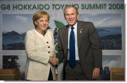 President George W. Bush and Germany's Chancellor Angela Merkel shake hands after meeting Tuesday, July 8, 2008, at the G-8 Summit in Toyako, Japan.  White House photo by Eric Draper