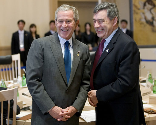 President George W. Bush and Prime Minister Gordon Brown of the United Kingdom, share a moment Tuesday, July 8, 2008, prior to the morning's G-8 Working Session at the Windsor Hotel Toya Resort and Spa in Toyako, Japan. White House photo by Eric Draper