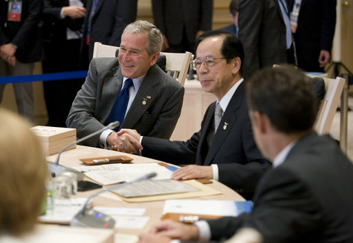 President George W. Bush exchanges handshakes with Prime Minister Yasuo Fukuda of Japan, Tuesday, July 8, 2008, as the G-8 leaders began their morning working session at the Windsor Hotel Toya Resort and Spa in Toyako, Japan. White House photo by Eric Draper