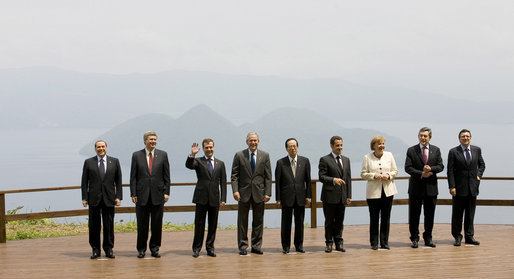With Lake Toya as a backdrop, leaders of the Group of Eight pose for the official family photograph Tuesday, July 8, 2008, in Toyako, Japan. White House photo by Eric Draper