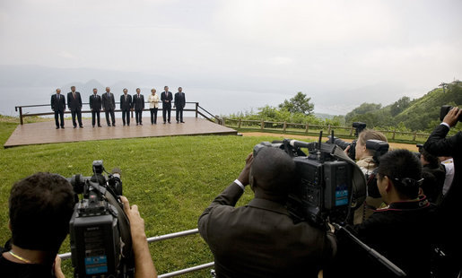 Photographers train their lenses on the G-8 leaders Tuesday, July 8, 2008, as they pose for the official family photograph in Toyako, Japan. In the background is Lake Toya. White House photo by Eric Draper