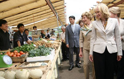 Mrs. Laura Bush joins spouses of the G-8 leaders as they visit the Hokkaido Marche (northern farm market), in Makkari Village Tuesday, July 8, 2008. The Hokkaido Marche was especially organized by the local residents on the occasion of the Summit, with the aim of illustrating the richness of locally produced foods. White House photo by Shealah Craighead