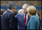President George W. Bush speaks with Prime Minister Gordon Brown, United Kingdom, and Chancellor Angela Merkel, Germany, during the final day of the G-8 Summit Wednesday, July 9, 2008, in Toyako, Japan. White House photo by Eric Draper