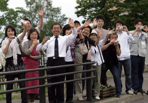 Crowds wave as the motorcade of the Mrs. Laura Bush travels to the Lake Toya Visitors Center Wednesday, July 9, 2008, in Hokkaido, Japan. White House photo by Shealah Craighead