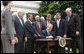 President George W. Bush, joined by members of his Cabinet and members of Congress, signs the FISA Amendments Act of 2008 Thursday, July 10, 2008, in the Rose Garden at the White House. White House photo by Eric Draper