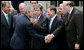President George W. Bush shakes hands Thursday, July 10, 2008, with Senator Jay Rockefeller of West Virginia, after signing the FISA Amendments Act of 2008 in the Rose Garden at the White House. White House photo by Chris Greenberg