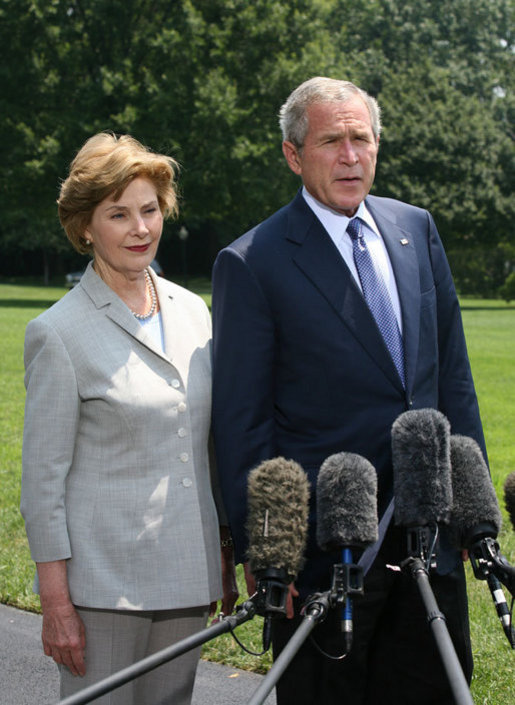 President George W. Bush and Mrs. Laura Bush meet with reporters Sunday, July 13, 2008 upon their arrival back to the White House, to express their sadness on the death of former White House Press Secretary Tony Snow. White House photo by Joyce N. Boghosian