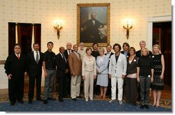 Mrs. Laura Bush poses with the winners of the 2008 Cooper-Hewitt National Design Awards at the White House on July 14, 2008. The awards are given in various disciplines such as communications, architecture, landscape, product, interior, fashion and people's design as well as in lifetime achievement, corporate achievement, special jury commendation. They awards are a tool to increase national awareness of design by promoting excellence, innovation and lasting achievement. The award program was first launched in 2000 at the White House as an official project of the White House Millennium Council. White House photo by Shealah Craighead