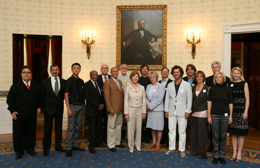 Mrs. Laura Bush poses with the winners of the 2008 Cooper-Hewitt National Design Awards at the White House on July 14, 2008. The awards are given in various disciplines such as communications, architecture, landscape, product, interior, fashion and people's design as well as in lifetime achievement, corporate achievement, special jury commendation. The awards are a tool to increase national awareness of design by promoting excellence, innovation and lasting achievement. The award program was first launched in 2000 at the White House as an official project of the White House Millennium Council. White House photo by Shealah Craighead