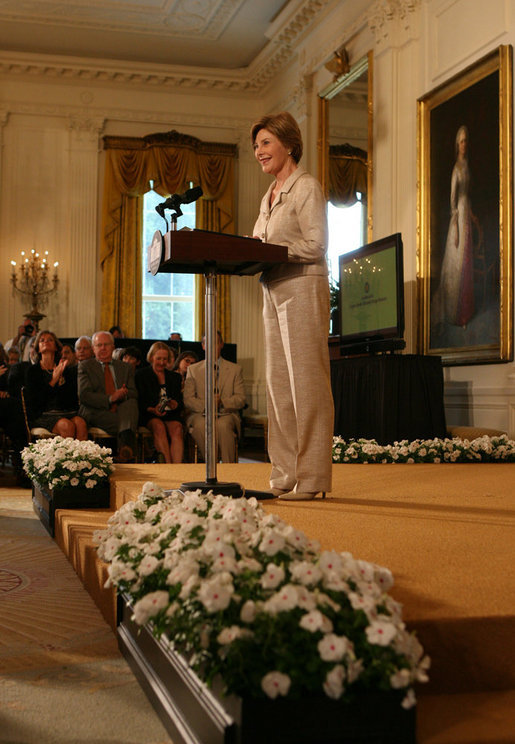 Mrs. Laura Bush welcomes attendees of the 2008 Cooper-Hewitt National Design Awards on July 14, 2008 in the White House East Room. The awards are given in various disciplines such as communications, architecture, landscape, product, interior, fashion and people's design as well as in lifetime achievement, corporate achievement, special jury commendation. The awards are a tool to increase national awareness of design by promoting excellence, innovation and lasting achievement. The award program was first launched in 2000 at the White House as an official project of the White House Millennium Council. White House photo by Shealah Craighead
