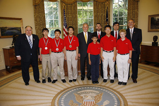 President George W. Bush welcomes the 2008 MATHCOUNTS National Competition Award winners to the Oval Office at the White House, Tuesday, July 15, 2008. From left are, math coach Jeffrey Boyd of Sugarland, Texas; Ding Zhou of Houston, Texas; Kevin Tian of Austin, Texas; Kevin Li of College Station, Texas; Darryl Wu of Bellevue, Wash.; coach Kristian Klaene of Lexington, Ky.; Anderson Wang of Ambler, Pa.; coach Lon-Chan Chu of Redmond, Wash.; Evan Miller of Owenboro, Ky., and coach David Hallas of Pittsburgh, Pa. White House photo by Eric Draper