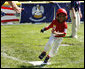 Maxwell Cowan of Eastern U.S. All-Stars rounds third base Wednesday, July 16, 2008, against the Central U.S. during an All-Star Tee Ball doubleheader on the South Lawn of the White House. White House photo by Eric Draper