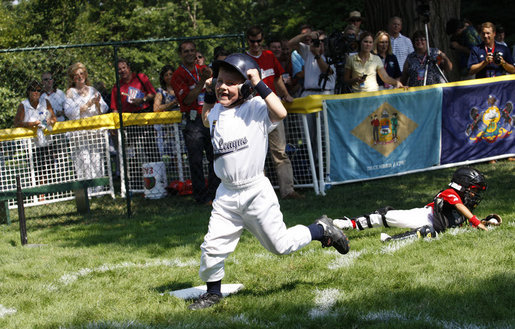Five-year-old Alex Thaler of the Eastern U.S. All-Stars makes a valiant effort as Jackson McGough of the Central U.S. All-Stars crosses the plate Wednesday, July 16, 2008, during All-Star Tee Ball at the White House. Players from across the United States gathered for the first time on the White House lawn to play the doubleheader that matched the Southern U.S. against the Western U.S. in the second game. White House photo by Eric Draper