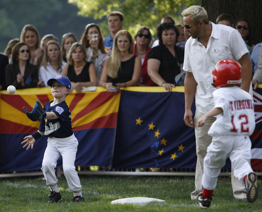 John Cloer, age 7, from Sierra Madre, Calif., makes the catch as West Virginia's Brody Kehrer, age 5, races to beat him to the base during All-Star tee ball action on the White House South Lawn on July 16, 2008. One child represented each state and the District of Columbia and teams were divided into four regions with California, represented on the Western team and West Virginia in the Southern team. White House photo by Eric Draper