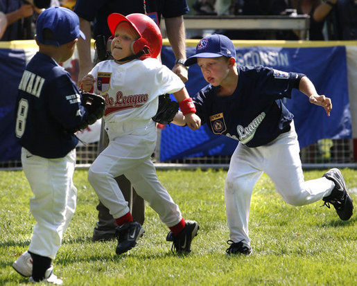 Reggie Graff, right, age 6, from St. George, Utah, tags North Carolina's Avery Shane, age 5, center, as Hawaii's Joshua Miyazawa, age 5, watches during All-Star tee ball action on July 16, 2008 on the South Lawn of the White House. Shane, from Rutherfordton, N.C., was on the Southern team and Graff and Miyazawa, from Honolulu were on the Western team. Two other teams, representing the Central and Eastern sections of the country, played and one child represented each state. President George W. Bush and Mrs. Laura Bush watched the action from a bleachers set up on the grounds for the kids' families. White House photo by Eric Draper