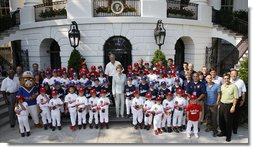 President George W. Bush and Mrs. Laura Bush stand with the All-Star Tee Ball teams and participants on the South Portico Wednesday, July 16, 2008, following a double-header at the White House, pitting Eastern U.S. against Central U.S. and Southern U.S. against Western U.S. White House photo by Eric Draper