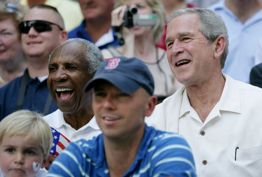 President George W. Bush and baseball Hall of Famer Frank Robinson, left, cheer on players participating in the Tee Ball on the South Lawn All-Star Game Wednesday, July 16, 2008, where the teams Eastern U.S. vs.Central U.S., and Southern U.S. vs. Western U.S., played in an afternoon doubleheader at the White House. White House photo by Chris Greenberg