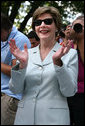 Mrs. Laura Bush shows her enthusiasm for the spirited game of tee ball as young All-Star players from across the United States gather to play on the White House South Lawn on July 16, 2008. President George W. Bush watched the game a few seats away on a bleachers set up for the event for the young players. White House photo by Shealah Craighead