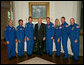 Vice President Dick Cheney stands with the crew members of the Space Shuttle Discovery (STS-124) Wednesday, July 16, 2008, during the astronauts' visit to the Vice President's Residence at the U.S. Naval Observatory in Washington, D.C. The crew made 217 orbits with a stop at the International Space Station during a two-week mission before returning home to Kennedy Space Center on June 14. White House photo by David Bohrer