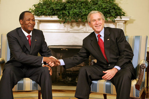 President George W. Bush shakes hands with Burkina Faso President Blaise Compaore, during a meeting Wednesday, July 16, 2008, in the Oval Office of the White House. White House photo by Joyce N. Boghosian