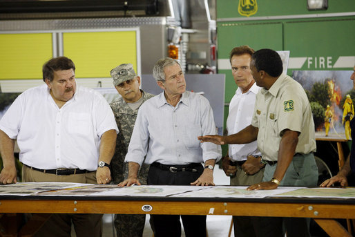 President George W. Bush, joined by California Governor Arnold Schwarzenegger, second from right, is briefed by U.S. Forest Service Regional Forester Randy Moore, right, Thursday, July 17, 2008 in Redding, Calif., during President Bush's tour to survey the wildfire damage in Northern California. White House photo by Eric Draper