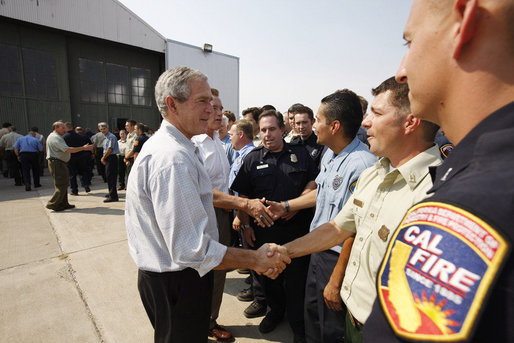 President George W. Bush, joined by California Governor Arnold Schwarzenegger, meets and thanks California public safety personnel Thursday, July 17, 2008 in Redding, Calif., for their efforts in battling the wildfires in Northern California. White House photo by Eric Draper