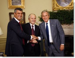 President George W. Bush shakes hands with Kosozo President Fatmir Sejdiu, center, and Kosovo Prime Minister Hashim Thaci, left, during a meeting Monday, July 21, 2008, in the Oval Office of the White House.  White House photo by Eric Draper