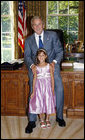 President George W. Bush poses for a photo with Catharine Aboulhouda, age 5, the 2008 March of Dimes National Ambassador, during her visit to the White House Monday, July 21, 2008, in the Oval Office. As the 2008 National Ambassador, Catharine will travel around the country with her parents, sharing her story to help other understand the seriousness of premature birth and the importance of supporting the March of Dimes' mission to help all babies be born full term and healthy. White House photo by Eric Draper
