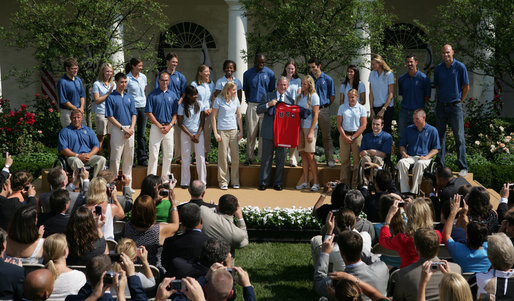 President George W. Bush joins the 2008 U.S. Olympic Team for a photo opportunity Monday, July 21, 2008, in the Rose Garden of the White House. White House photo by Shealah Craighead