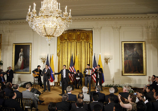 Jorge Celedon, Jimmy Zambrano, and their performance group perform during the celebration of Colombian Independence Day Tuesday, July 22, 2008, in the East Room of the White House. White House photo by Eric Draper
